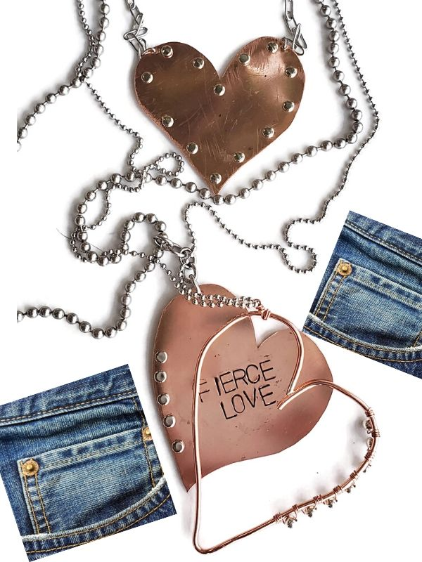 an assortment of riveted metal heart necklaces