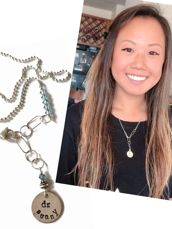 silver personalized charm necklace for job and modeled