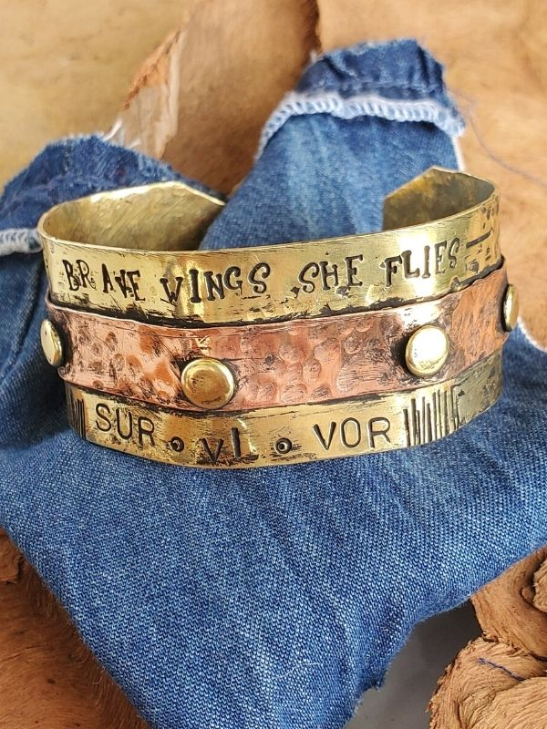 riveted metal survivor cuff on stones