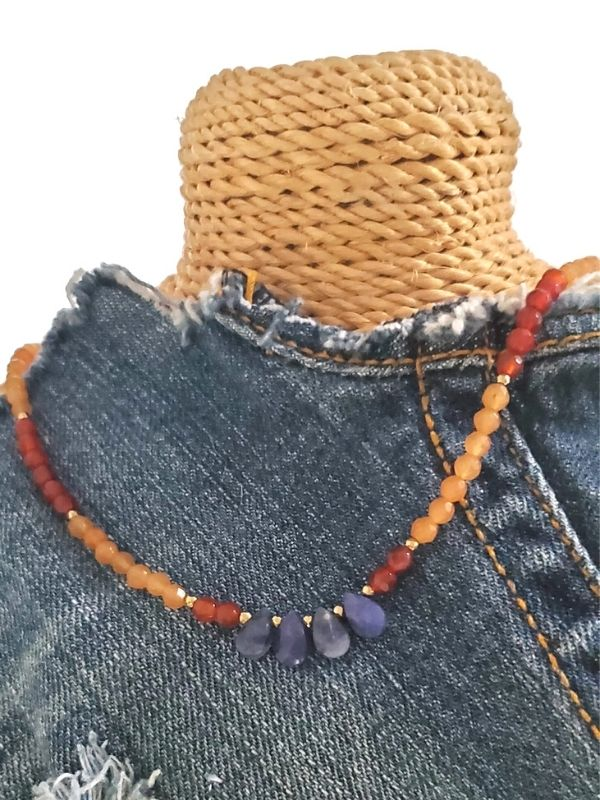 orange gemstone necklace on denim