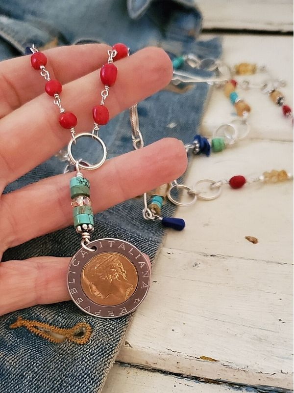 holding a gemstone Italian coin necklace