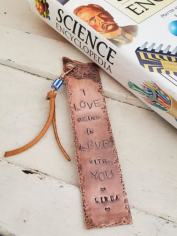 copper bookmark with science book