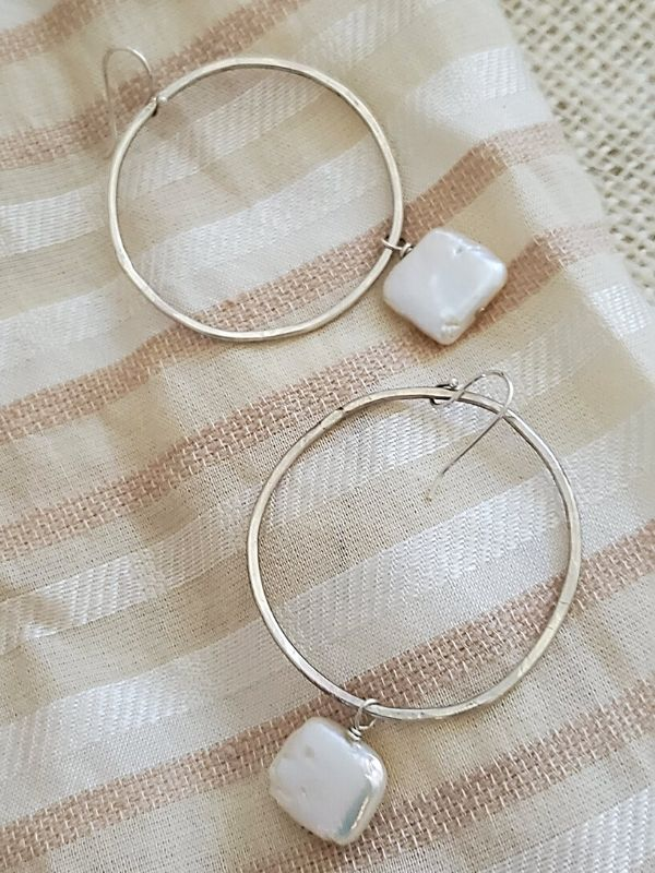 pearl hoop earrings on fabric